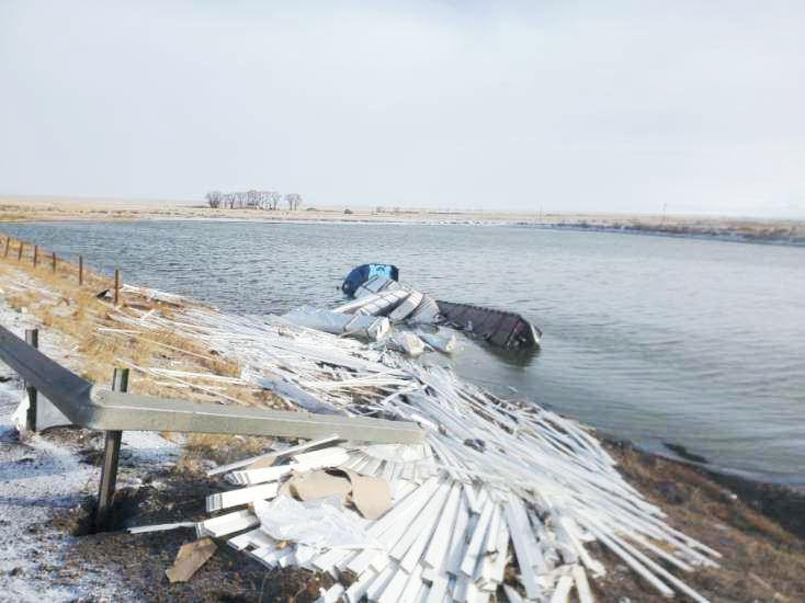 Semi accident in pond 3
