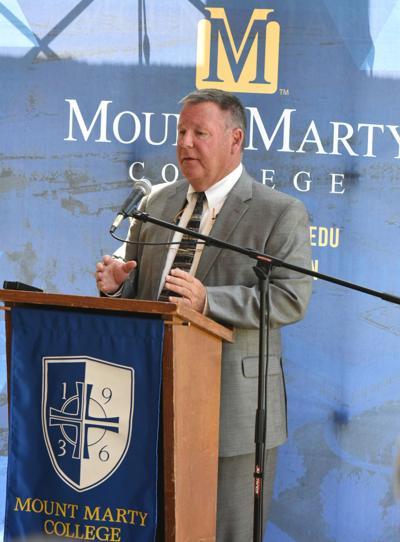 Woodley Named MMC Football Coach