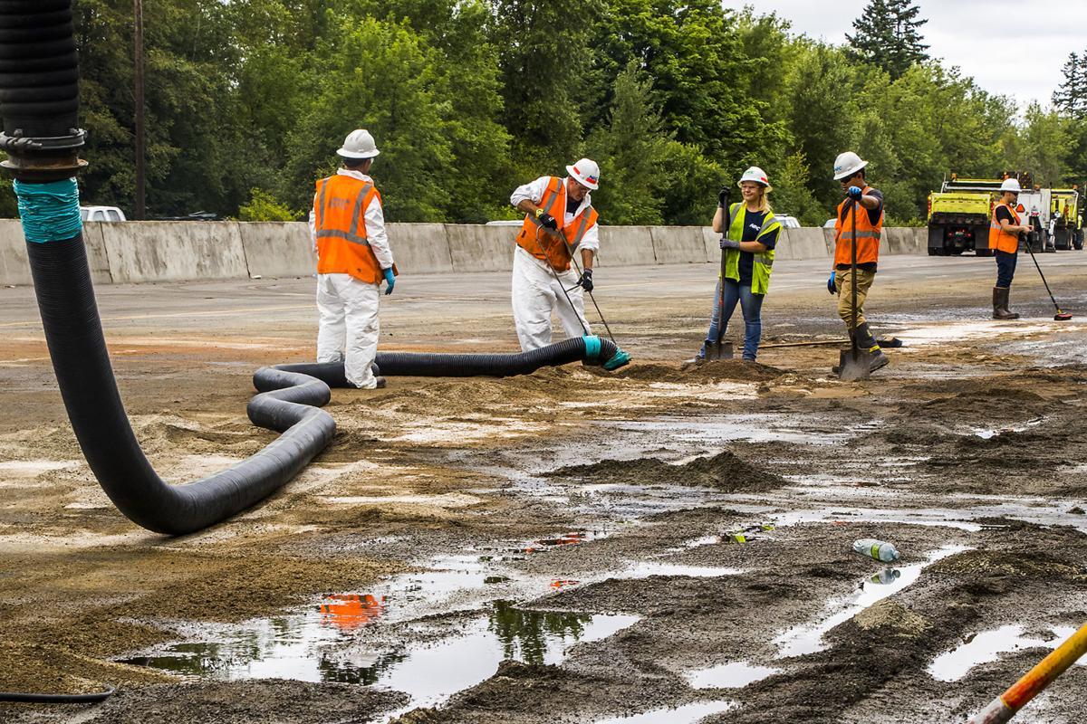 Crews Work To Clean Up Oil After Tanker Overturned
