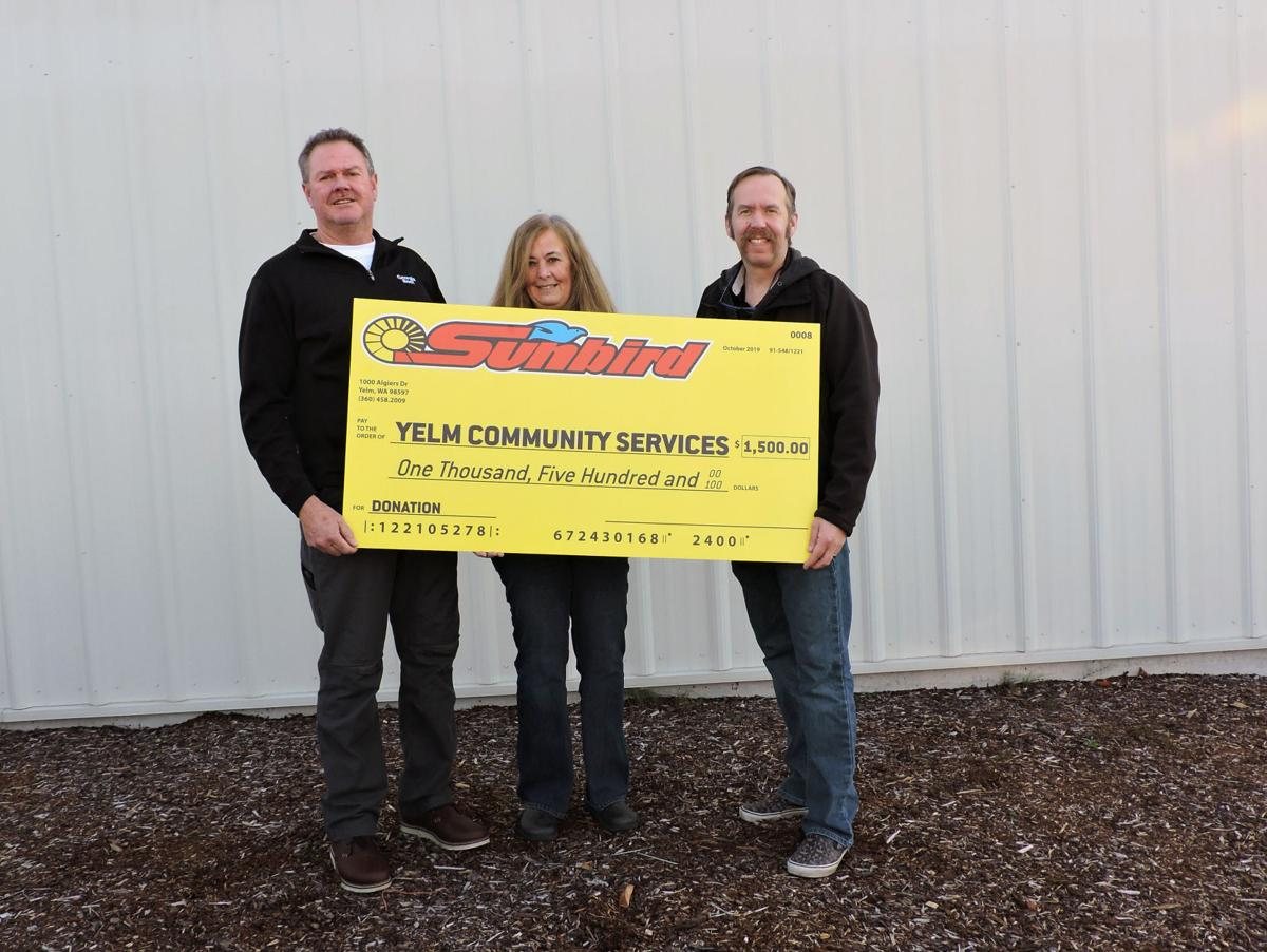 Sunbird Shopping Center Makes $1,500 Donation to Yelm Community Services Food Bank