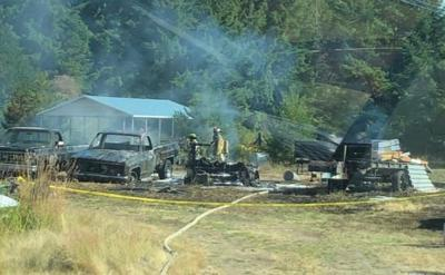 Firefighters Halt Brush Fire After Several Vehicles Are Burned in Yelm
