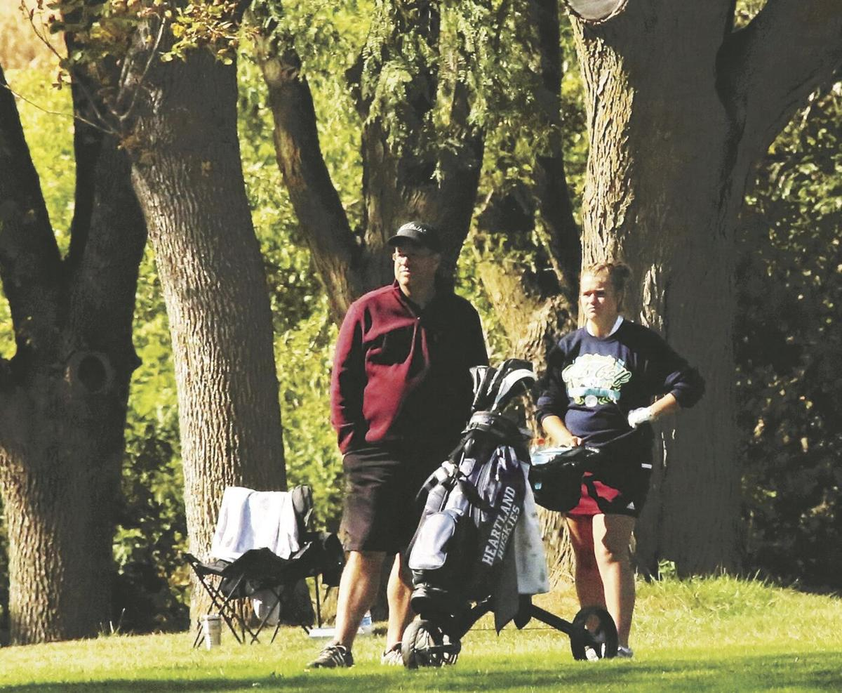 Dad and daughter Mestl assess a shot at state golf