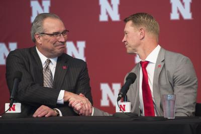 Bill Moose shakes hands with Scott Frost