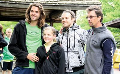Lily Holthus and Miles 2 Give founder Landon Cooper, Ryan Pries, and Jon McKay