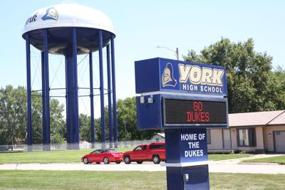 Dukes water tower, high school sign