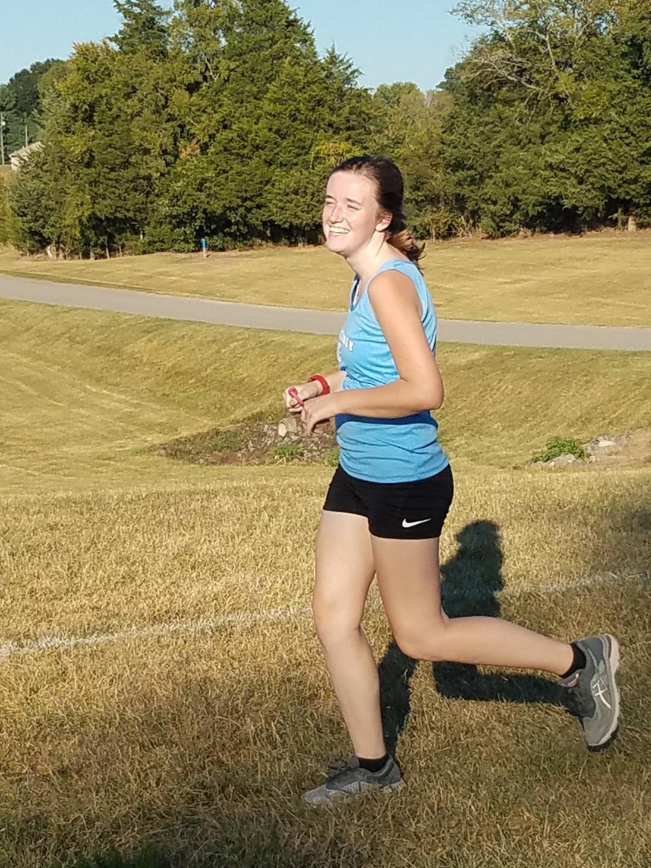 Conner running cross country.JPG