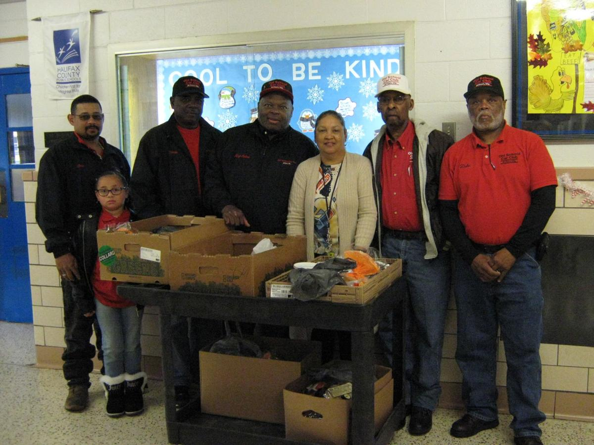 Old School Car Club makes donation to Sinai Elementary School