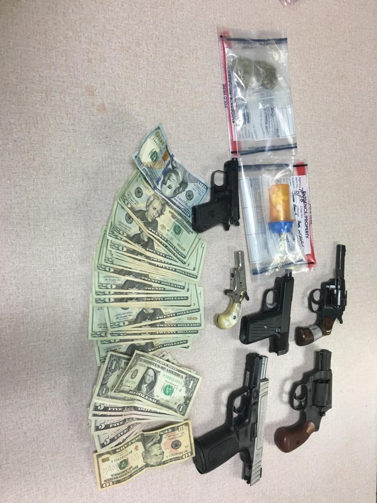 drugs, cash guns seized in raid.jpeg