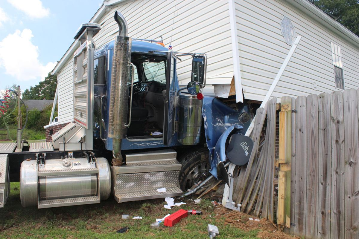 Logging truck in house