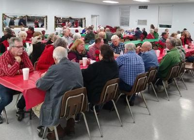 Scottsburg Tree of Lights names read during senior citizens supper